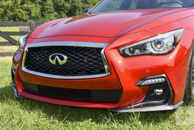 2018 Infiniti Q50 detail shot of the front of the car featuring the grill and headlights