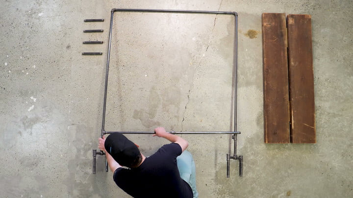 industrial-style clothing rack Attach the legs to the main body