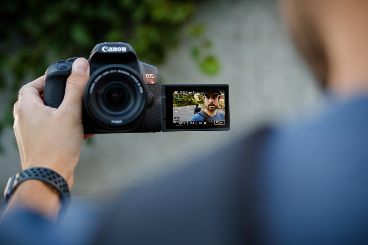 Product photo of the Canon EOS Rebel T8i in selfie mode.