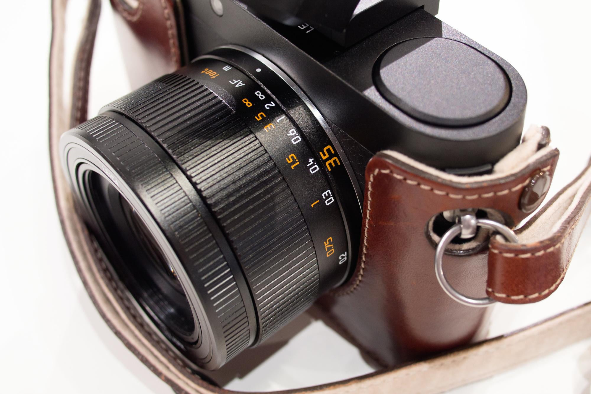 The 23mm f/1.7 Summilux-lens sports a manual focusing ring with distance  scale
