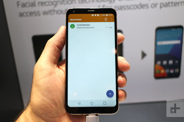 LG Q6 review in hand