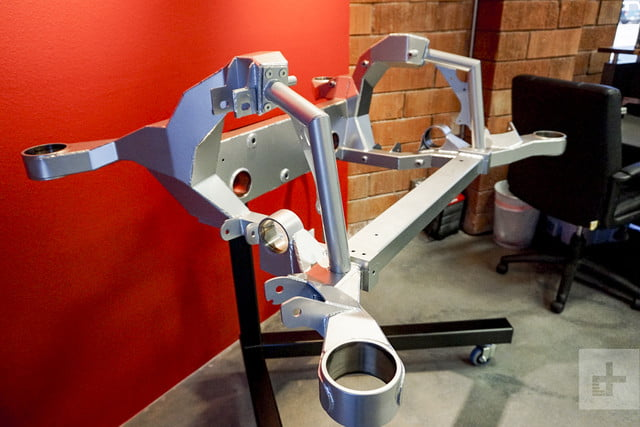A manufactured automotive piece is displayed at Motivo Engineering