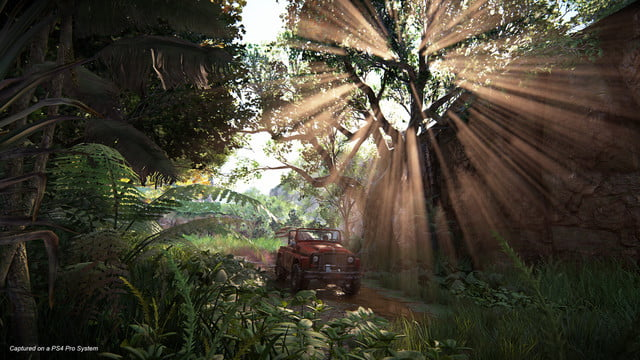 Uncharted: The Lost Legacy Nadine and Chloe driving a humvee through streams of light in a forest